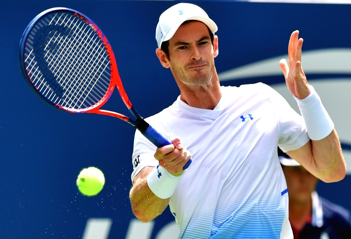 NEW YORK, Aug. 28, 2018 (Xinhua) -- Andy Murray of Britain hits a return during the men's singles first round match against James Duckworth of Australia at the 2018 US Open tennis championships in New York, the United States, Aug. 27, 2017. Murray wo