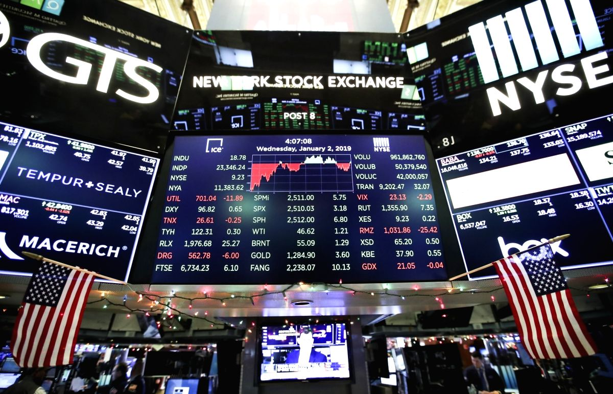 NEW YORK, Jan. 2, 2019 (Xinhua) -- Electronic screens with trading data are seen at the New York Stock Exchange in New York, the United States, on Jan. 2, 2019. U.S. stocks ended slightly higher on Wednesday, starting a new year with a fluctuant trad