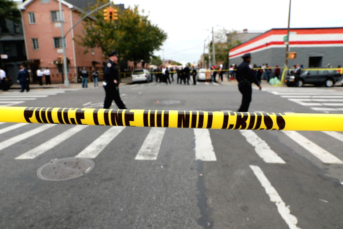 NEW YORK, Oct. 12, 2019 (Xinhua) -- Police cordon off a street near the scene of a shooting in New York, the United States, on Oct. 12, 2019. Four people were killed and three others injured in a shooting in New York's Brooklyn borough on early Satur