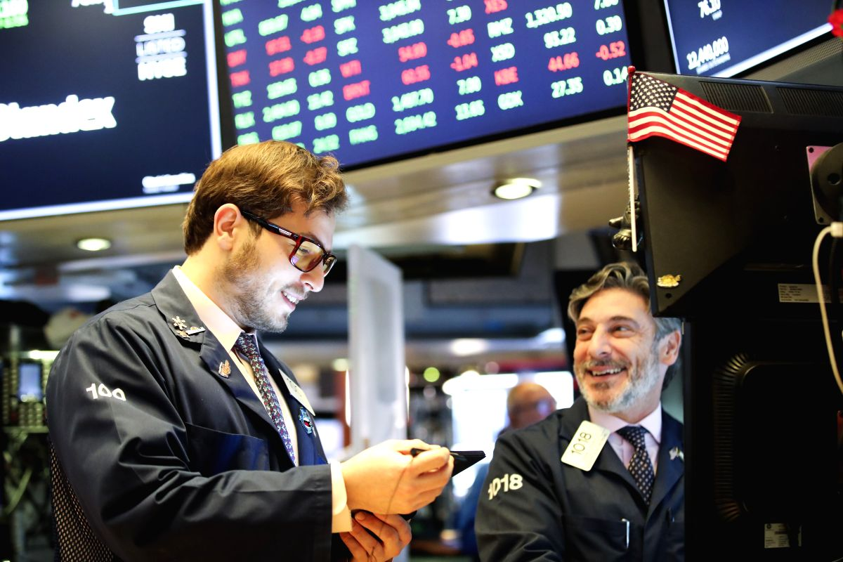 NEW YORK, Oct. 30, 2019 (Xinhua) -- Traders work at the New York Stock Exchange in New York, the United States, on Oct. 30, 2019. U.S. stocks ended higher on Wednesday. The Dow rose 0.43 percent to 27,186.69, the S&P 500 increased 0.33 percent to 3,0