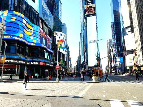 "New York's Times Square is almost deserted on Saturday, March 14, 2020, because of the coronavirus pandemic. Called the ""Crossroads of the World,"" Times Square is usually crowded with tourists from around the world and New Yorkers on a weekend. ("