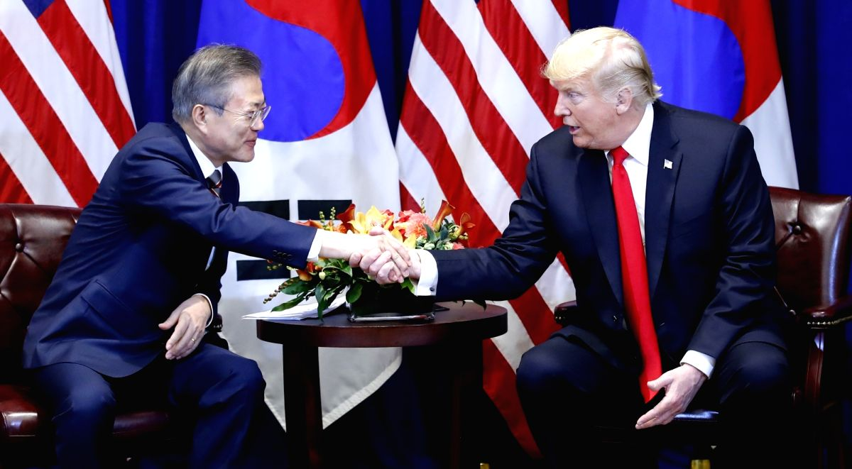 New York: South Korean President Moon Jae-in (L) shakes hands with U.S. President Donald Trump during their summit talks at a New York hotel on Sept. 24, 2018.(Yonhap/IANS)