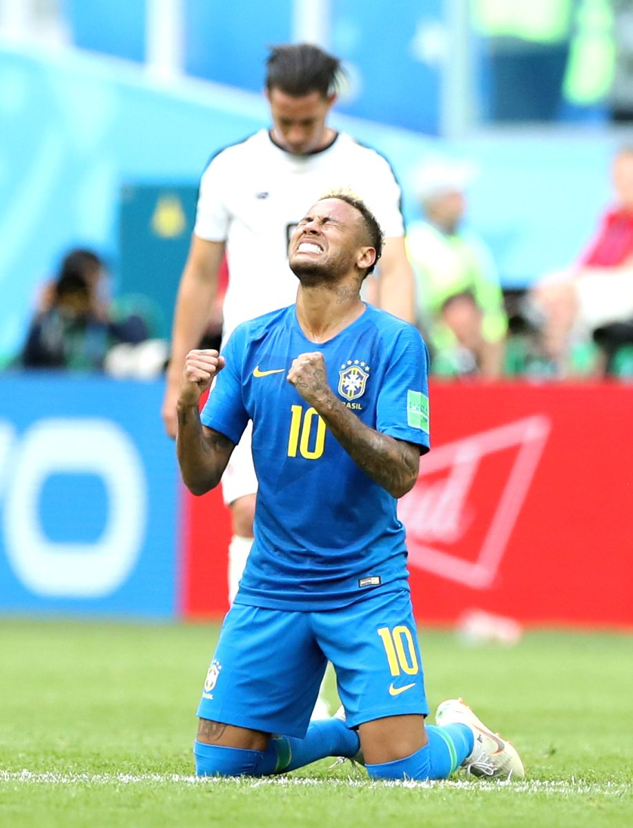 Stressed out Neymar kneels down after victory against Costa Rica