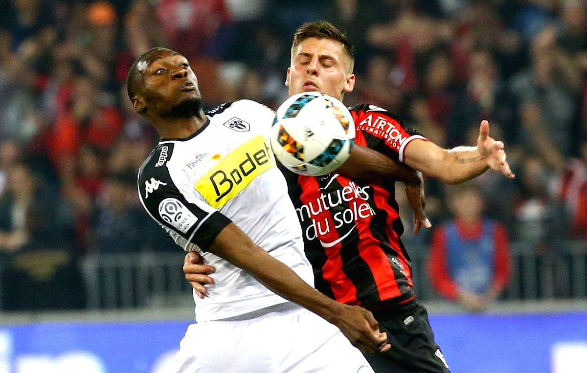 NICE, May 15, 2017 - Remi Walter (R) from OGC Nice competes with Karl Toko Ekambi (L) from SCO Angers during a French Ligue 1 match in Nice, France on May 14, 2017. OGC Nice lose 0-2 at home.