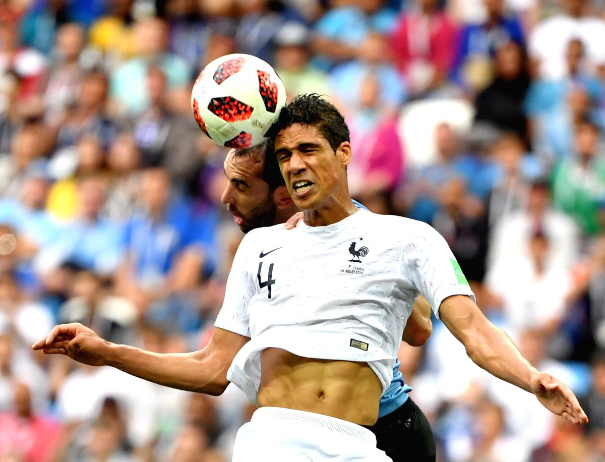NIZHNY NOVGOROD, July 6, 2018 (Xinhua) -- Diego Godin (L) of Uruguay competes for a header with Raphael Varane of France during the 2018 FIFA World Cup quarter-final match between Uruguay and France in Nizhny Novgorod, Russia, July 6, 2018. (Xinhua/L