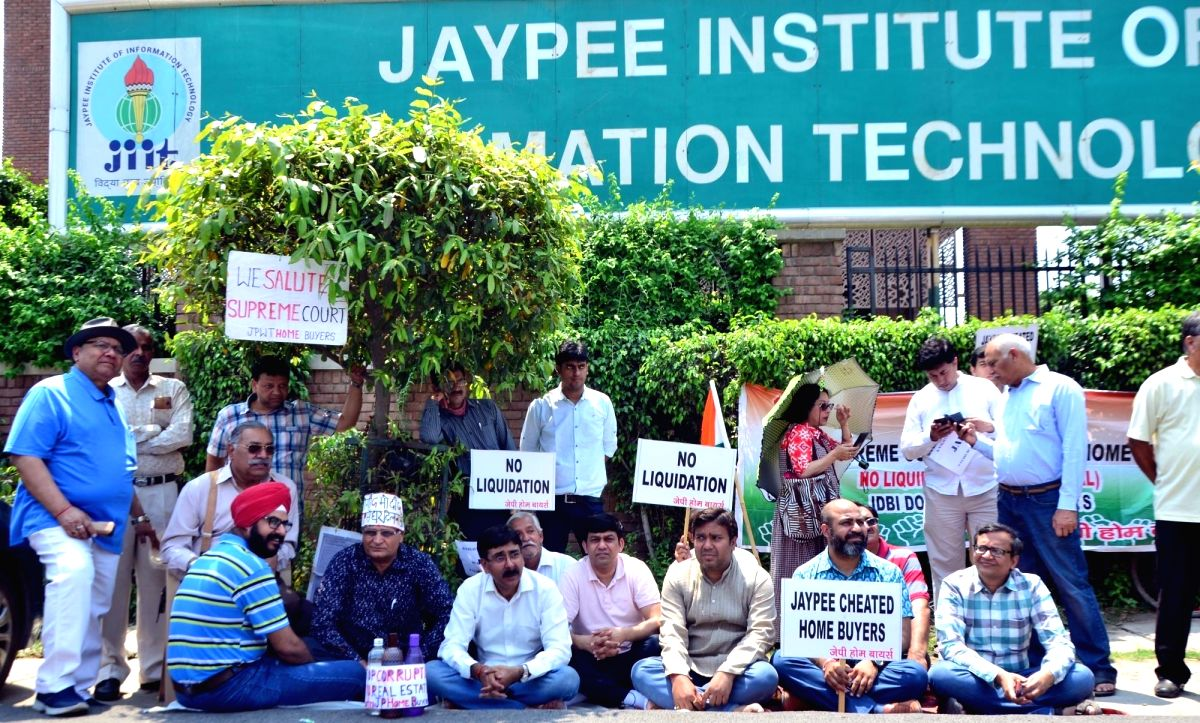 Noida: Home buyers of the debt-ridden Jaypee Infratech stage a demonstration against the company, outside the venue where the company's management is holding a meeting with the home buyers, in Noida, on April 19, 2019.
