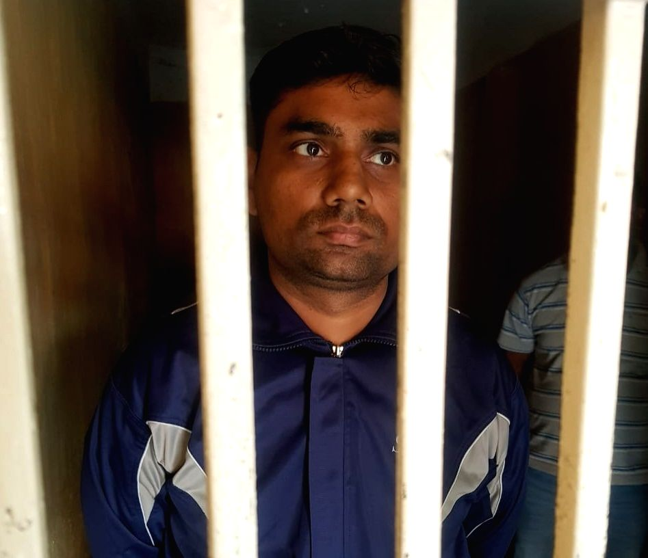 Noida: One of the four officials of the Uttar Pradesh Home Guard unit who were been arrested in the salary scam case of the security force, in Noida on Nov 20, 2019.