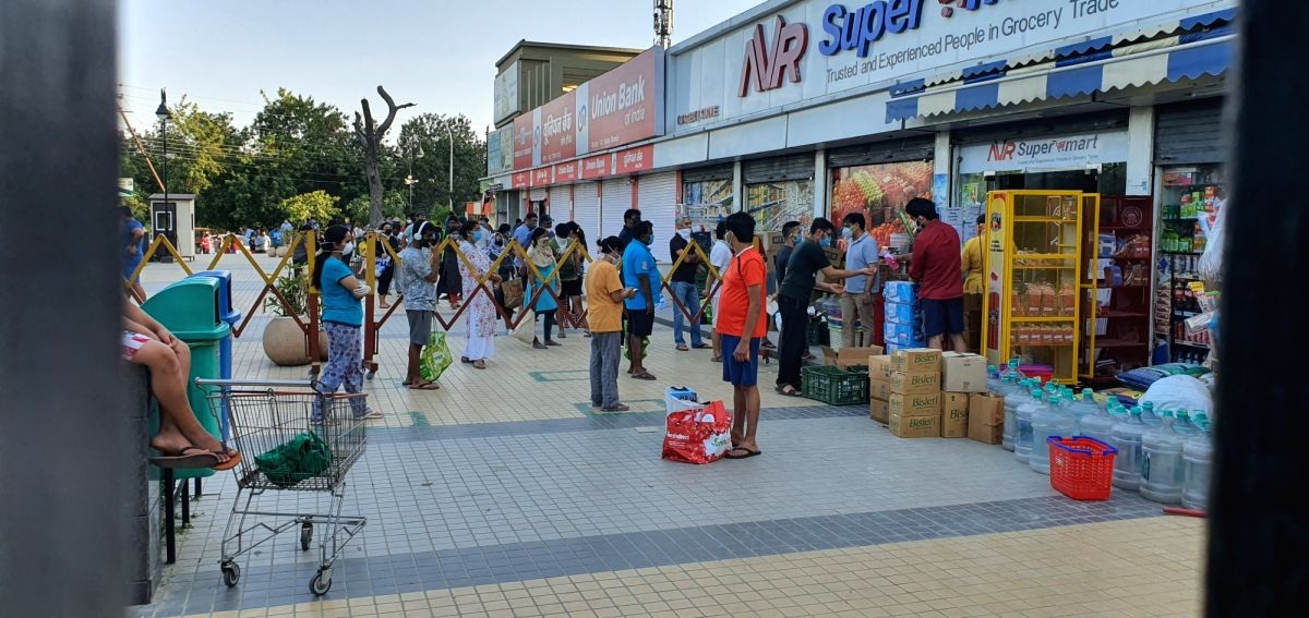 Noida: People seen panic buying in Noida Sec 143 after Yogi Adityanath government's decision to 'firmly implement' the lockdown and 'completely seal' the hotspots in 15 districts of Uttar Pradesh that have emerged as Corona hotspots, on Apr 8, 2020.