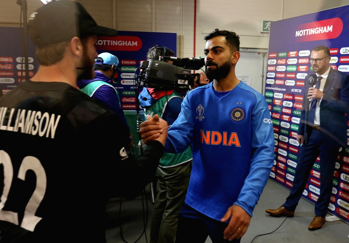 Nottingham: Indian skipper Virat Kohli shakes hands with New Zealand captain Kame Williamson after the 18th Match of World Cup 2019 between India and New Zealand at the Trent Bridge Cricket Ground was abandoned due to rains, in Nottingham, England on