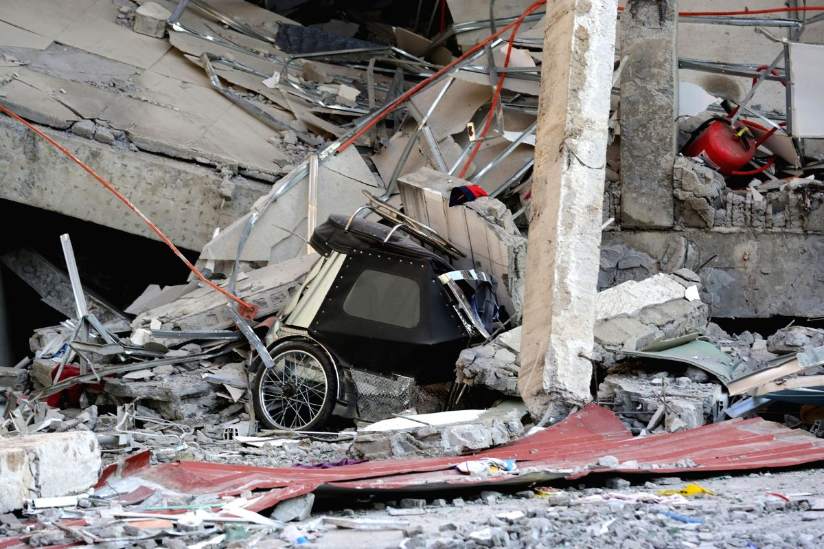 Pampanga Province, April 23, 2019 (Xinhua) -- A tricycle is seen under a collapsed building in Pampanga Province, the Philippines, April 23, 2019. The death toll from the 6.1-magnitude earthquake that struck the Philippines' main Luzon Island rose to
