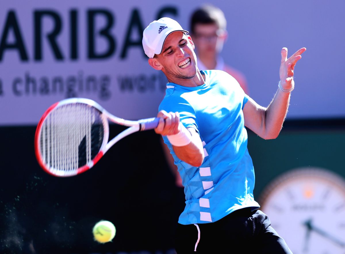 PARIS, June 2, 2019 (Xinhua) -- Dominic Thiem of Austria hits a return during the men's singles third round match against Pablo Cuevas of Uruguay at French Open tennis tournament 2019 at Roland Garros, in Paris, France, on June 1, 2019. Dominic Thiem