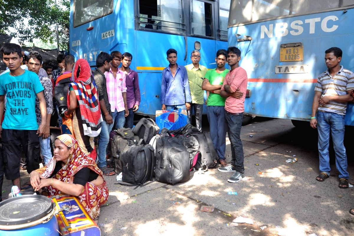 Passengers wait to board a bus at the North Bengal Bus Terminus after bus services to and from northern West Bengal, which is reeling under floods, resumed on Aug 17, 2017.