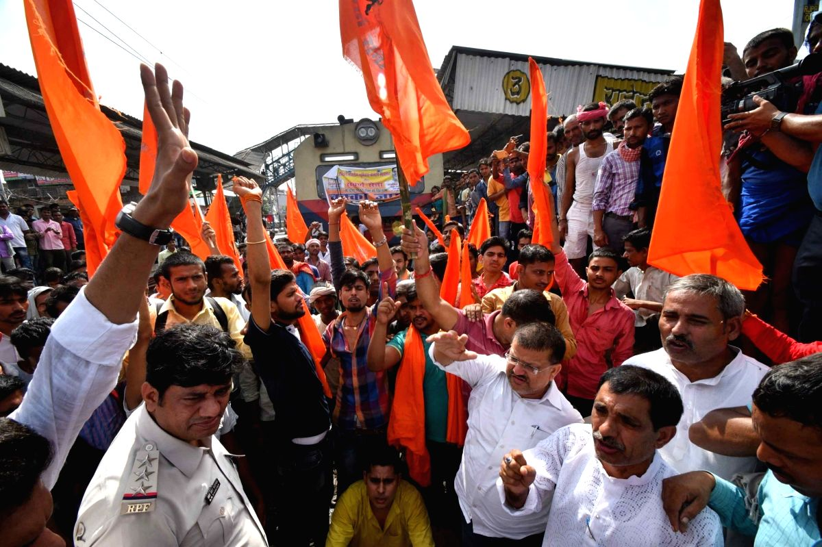 Patna: Activists of Swarna Sena and Akhil Bhartiya Brahmin Mahasabha block railway tracks and disrupt railway services as they stage a demonstration over the SC/ST Atrocities Bill, in Patna on Aug 9, 2018.