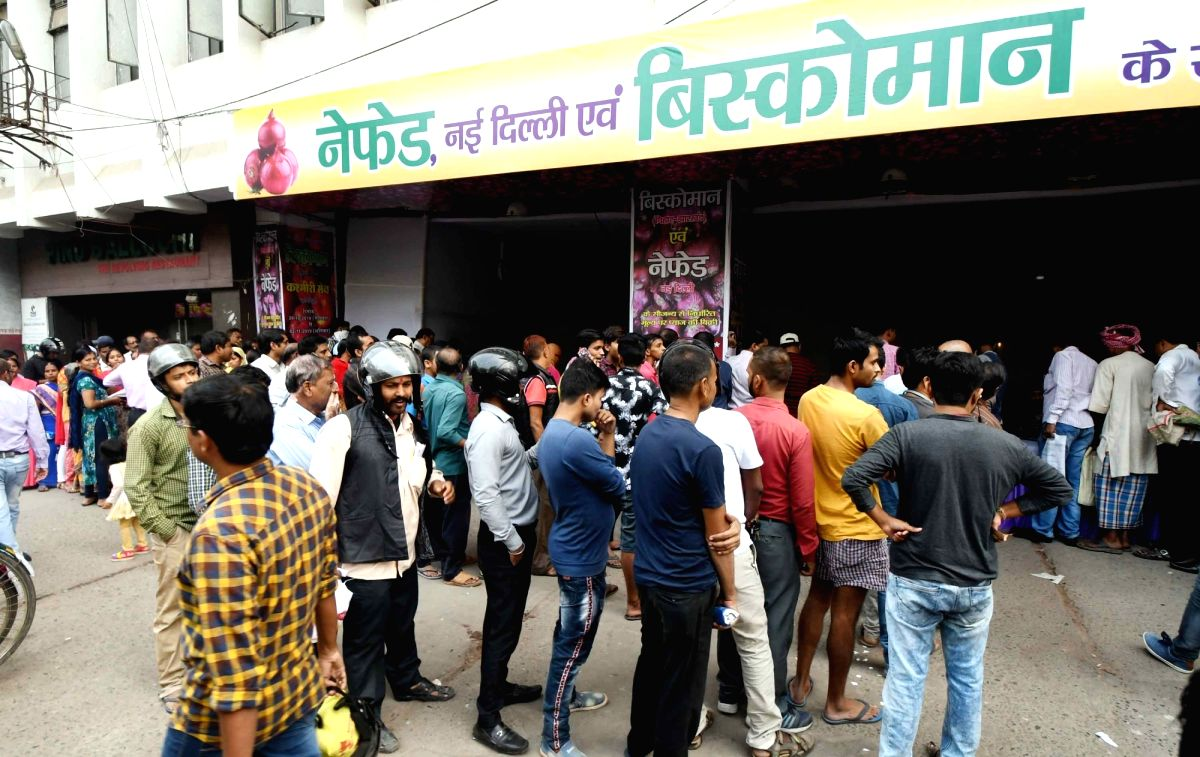 Patna: People gather at Biscomaun Bhawan to purchase onions, where the vegetable is being sold at a subsidised price of Rs 35 a Kg, with the help of National Agricultural Cooperative Marketing Federation of India (NAFED), in Patna on Nov 22, 2019. (P