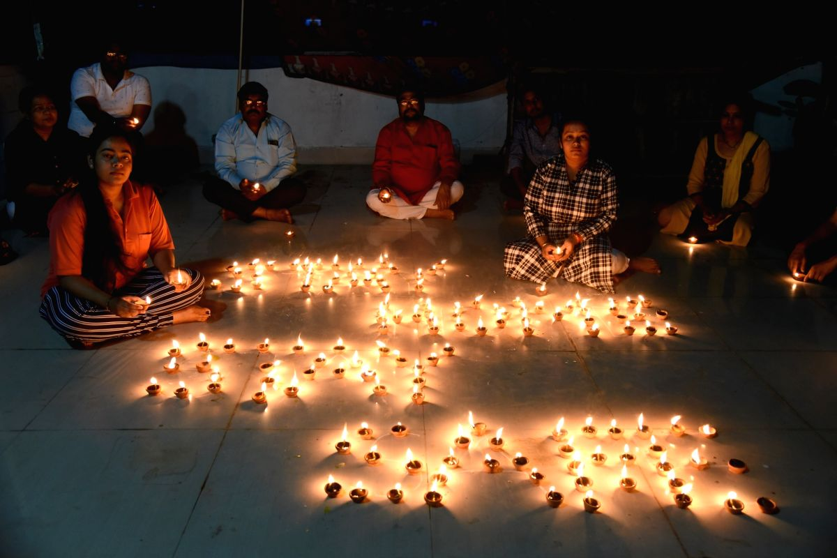 Patna: People light 'diyas' and candles in their balconies after Prime Minister Narendra Modi urged people in a video message to the nation to turn off their lights for nine minutes at 09:00 pm on April 5 and light a candle or a 'diya' or even use th