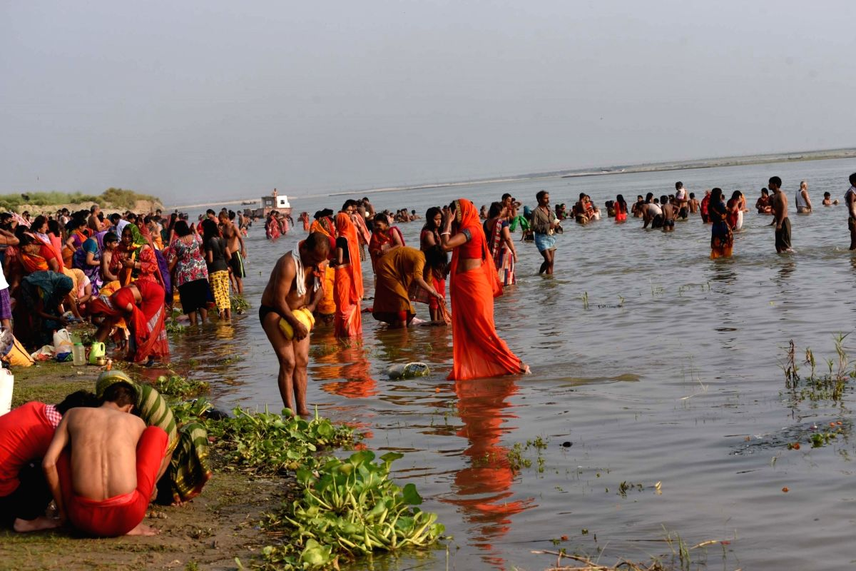 Patna: People perform rituals on the banks of the Ganga river on the occasion of Ganga Dussehra in Patna on the first day of the fifth phase of the nationwide lockdown imposed to mitigate the spread of coronavirus, on June 1, 2020.
