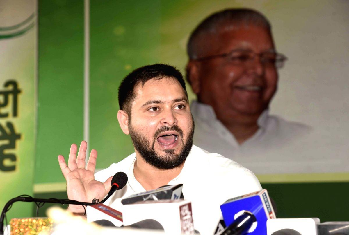 Patna: RJD leader Tejashwi Yadav addresses a press conference in Patna on Sep 23, 2020.