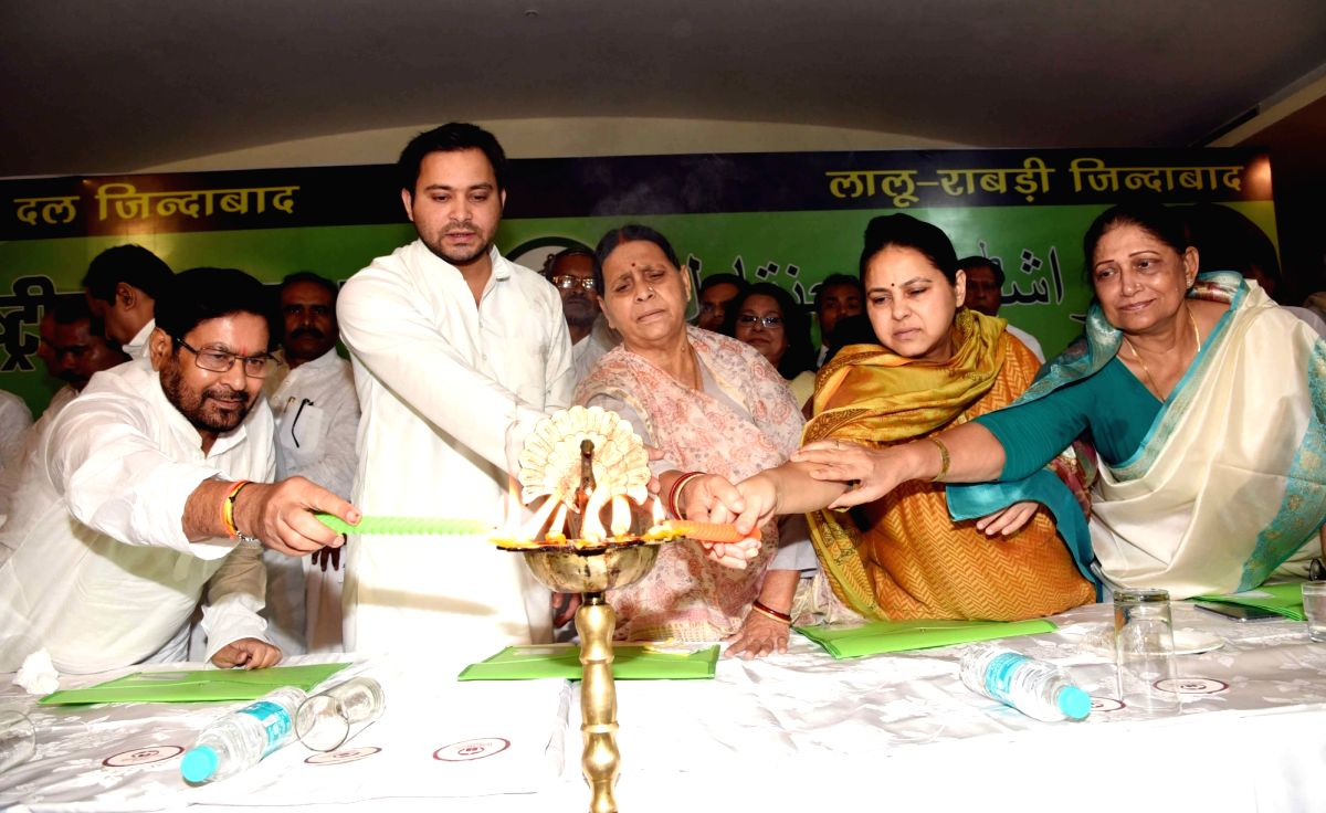 Patna: RJD leaders Rabri DEvi, Misa Bhart and Tejashwi Yadav light the lamp to inaugurate the party's National Executive meeting, in Patna on July 6, 2019.