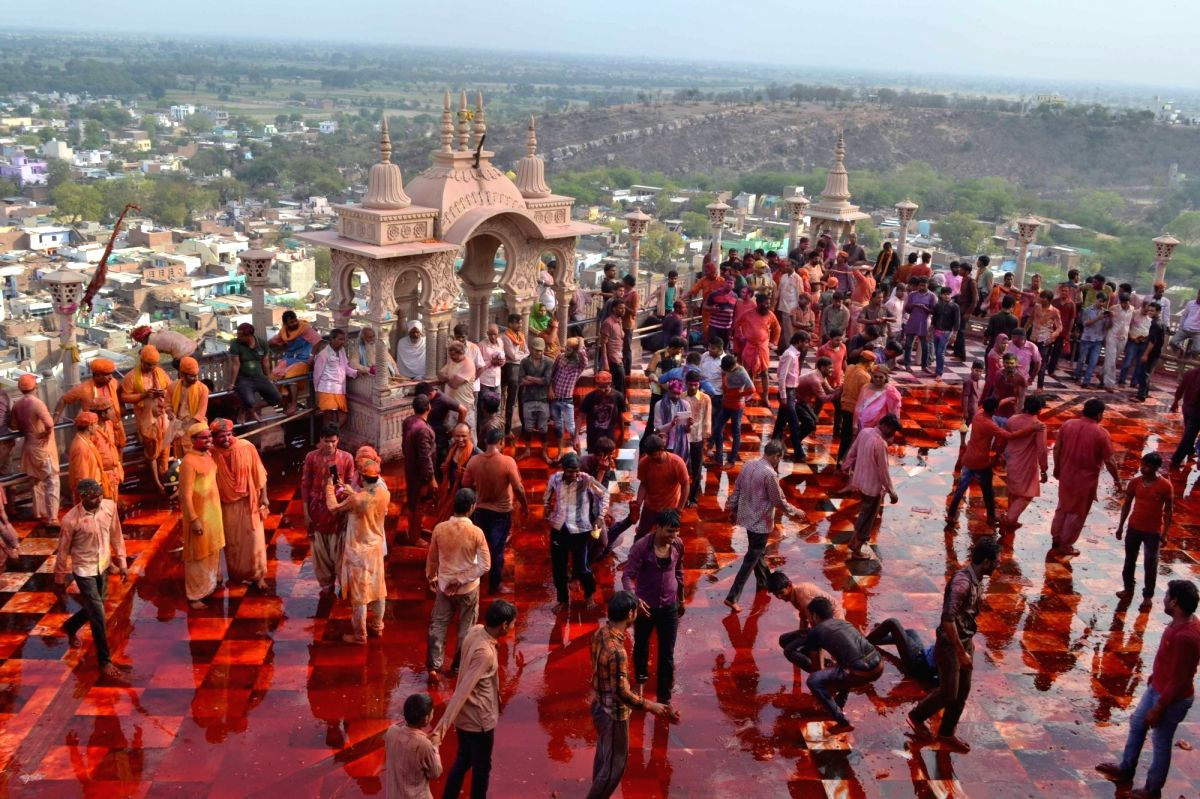 People celebrate Holi at Barsana temple near Mathura.
