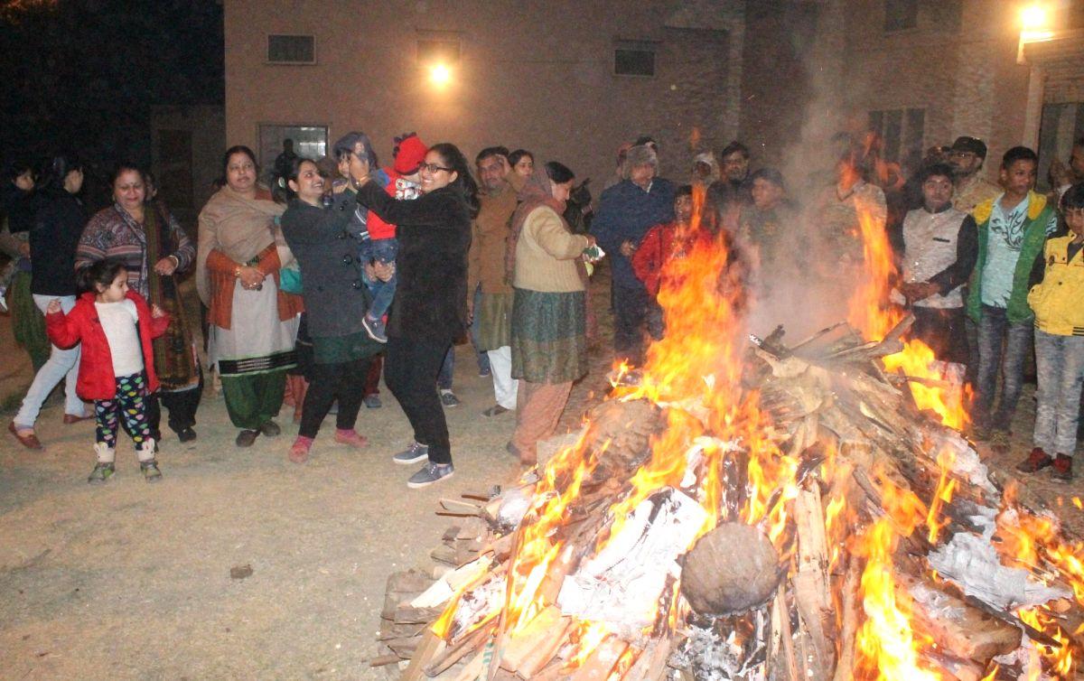 People celebrate Lohri in Mathura on Jan 13, 2017, (PhotoL: IANS)