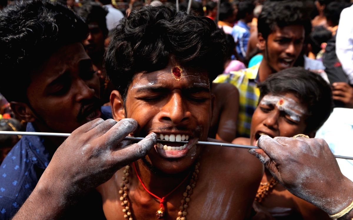 Boy's Mouth being pierced