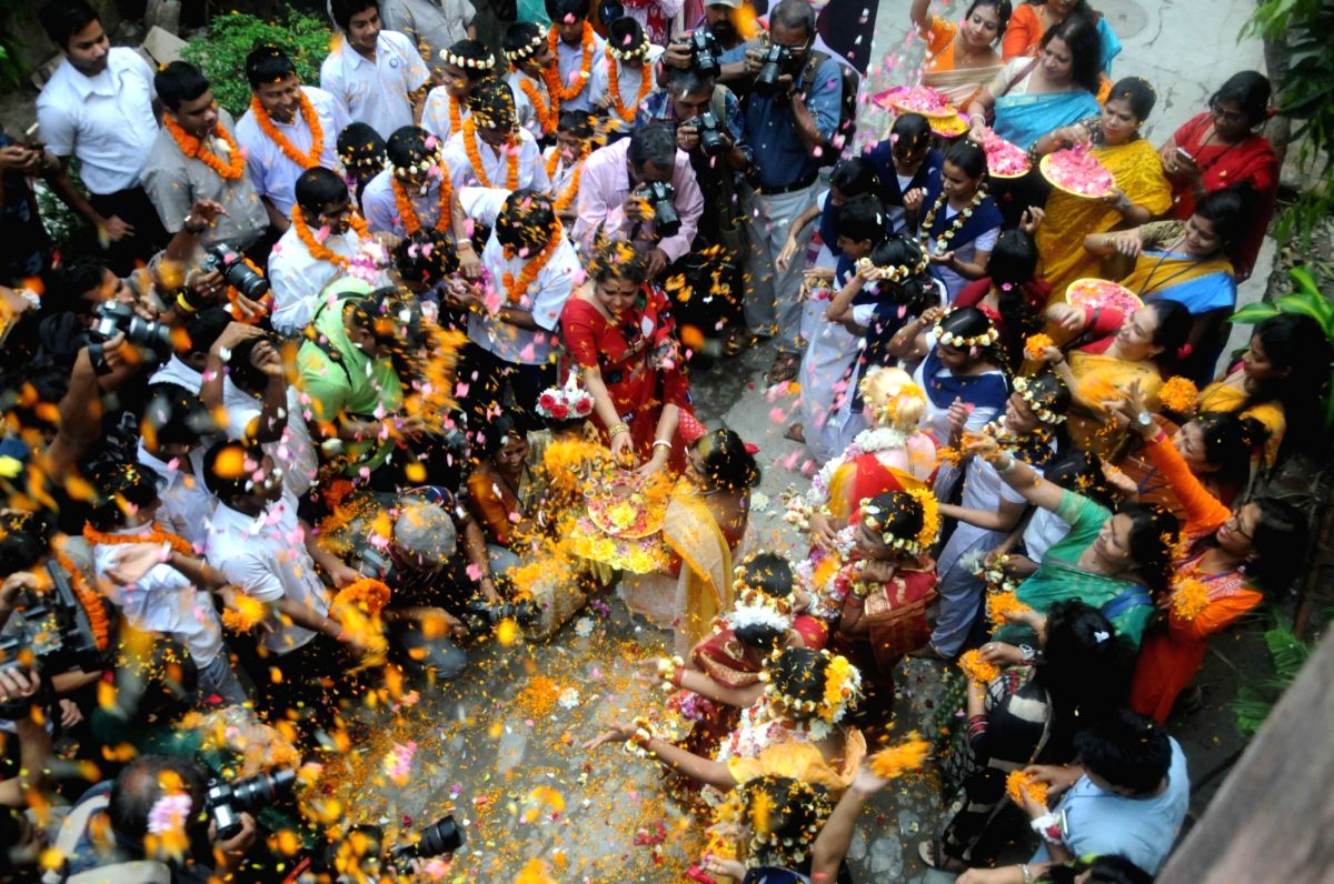 People play 'Holi' with flowers