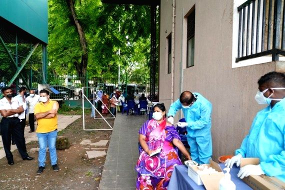 People receive COVID-19 vaccines at a vaccination center in Sri Lanka's capital Colombo. (Xinhua/Tang Lu/IANS)