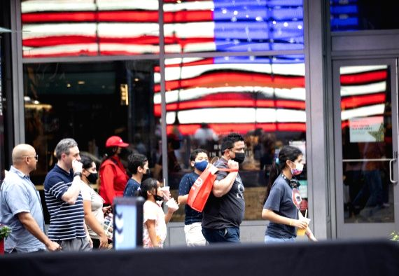 People walk in Times Square, New York, the United States, on July 20, 2021. (Xinhua/Wang Ying/IANS)