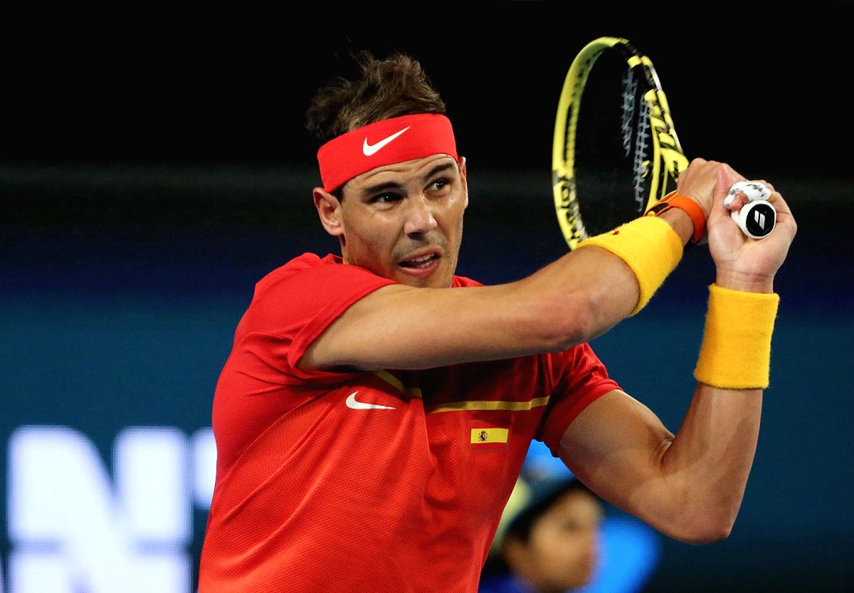PERTH, Jan. 4, 2020 (Xinhua) -- Rafael Nadal of Spain returns a shot during the ATP Cup Group B match against Nikoloz Basilashvili of Georgia in Perth, Australia, on Jan. 4, 2020. (Photo by Zhou Dan/Xinhua/IANS)