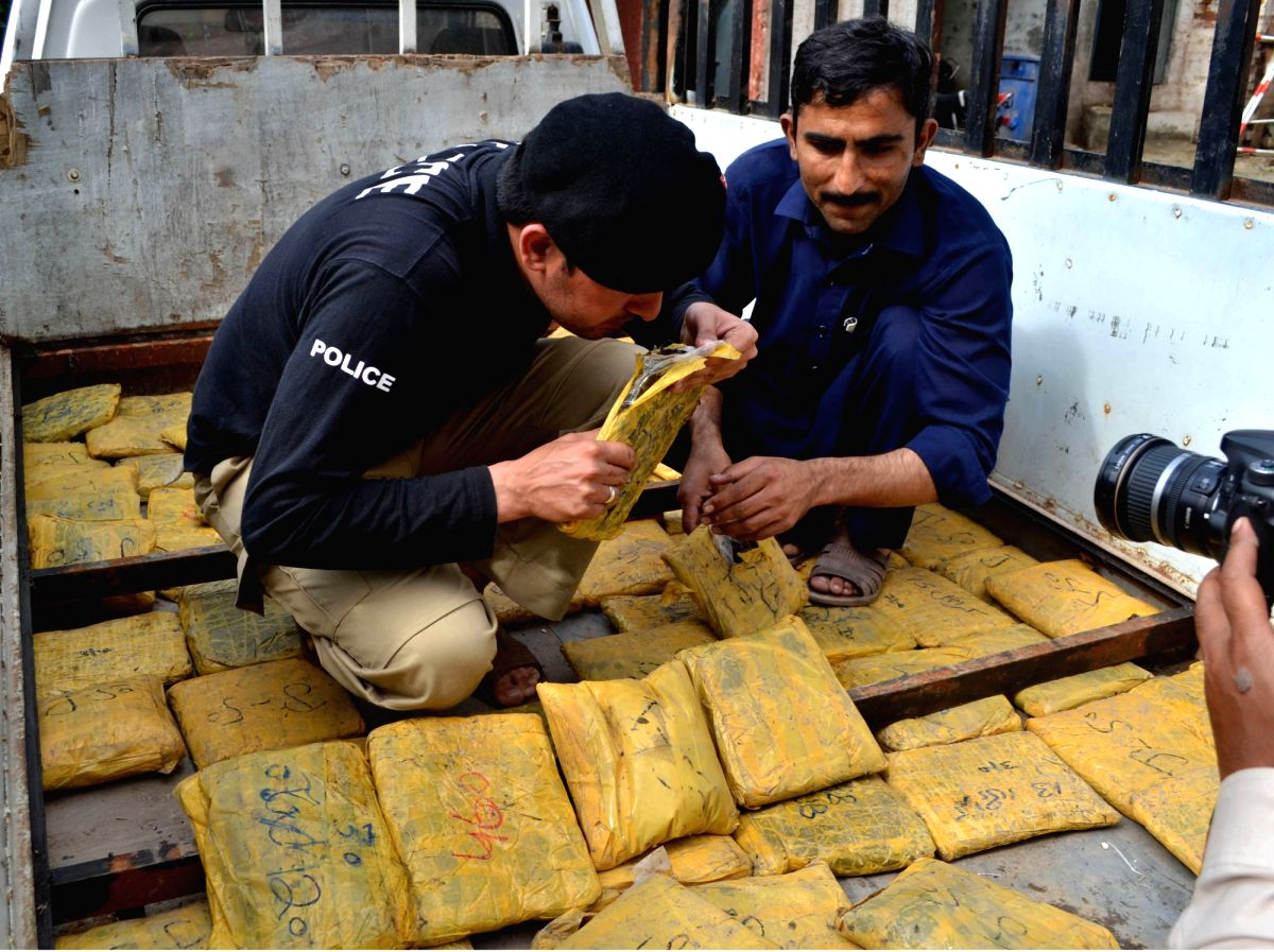 PESHAWAR, May 2, 2015 (Xinhua) -- Policemen examine packets of seized drugs at a police station in northwest Pakistan's Peshawar, May 2, 2015. Pakistani police sized a huge amount of hashish and arrested two suspects in Peshawar on Saturday. (Xinhua/