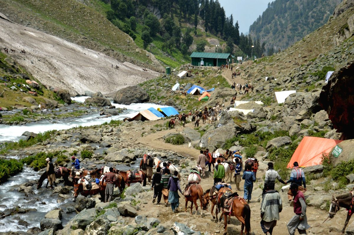Pilgrims on Amarnath Yatra -journey to the holy cave of Amarnath- in  Chandanwari of Jammu and Kashmir