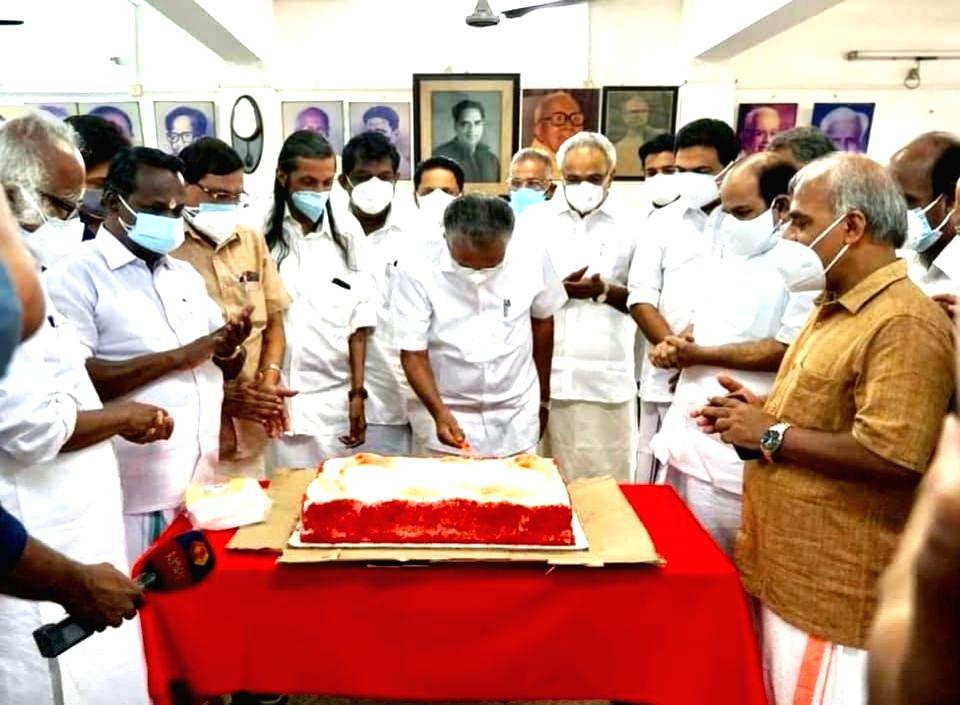 Pinarayi Vijayan cuts cake ahead of first LDF meeting after retaining power.