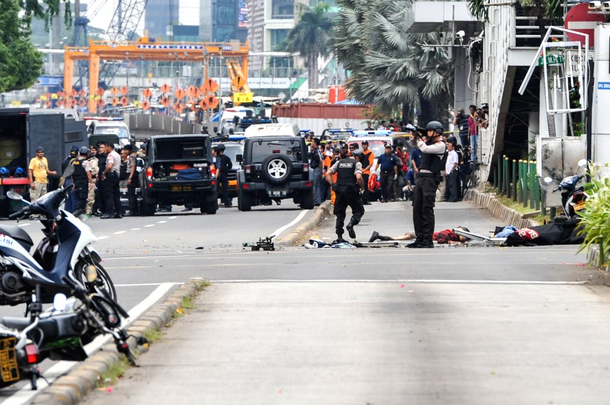 Policemen guard near the explosion site in Jakarta, Indonesia, Jan. 14, 2016. One policeman and three civilians were killed, and two other policemen were injured ...