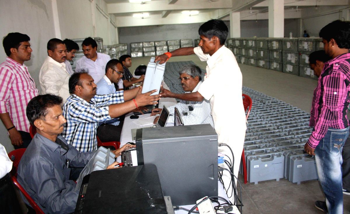 Polling personnel inspect Electronic Voting Machines (EVMs) at a polling station ahead of the 6th phase of 2014 Lok Sabha Elections in Lucknow on on April 21, 2014.