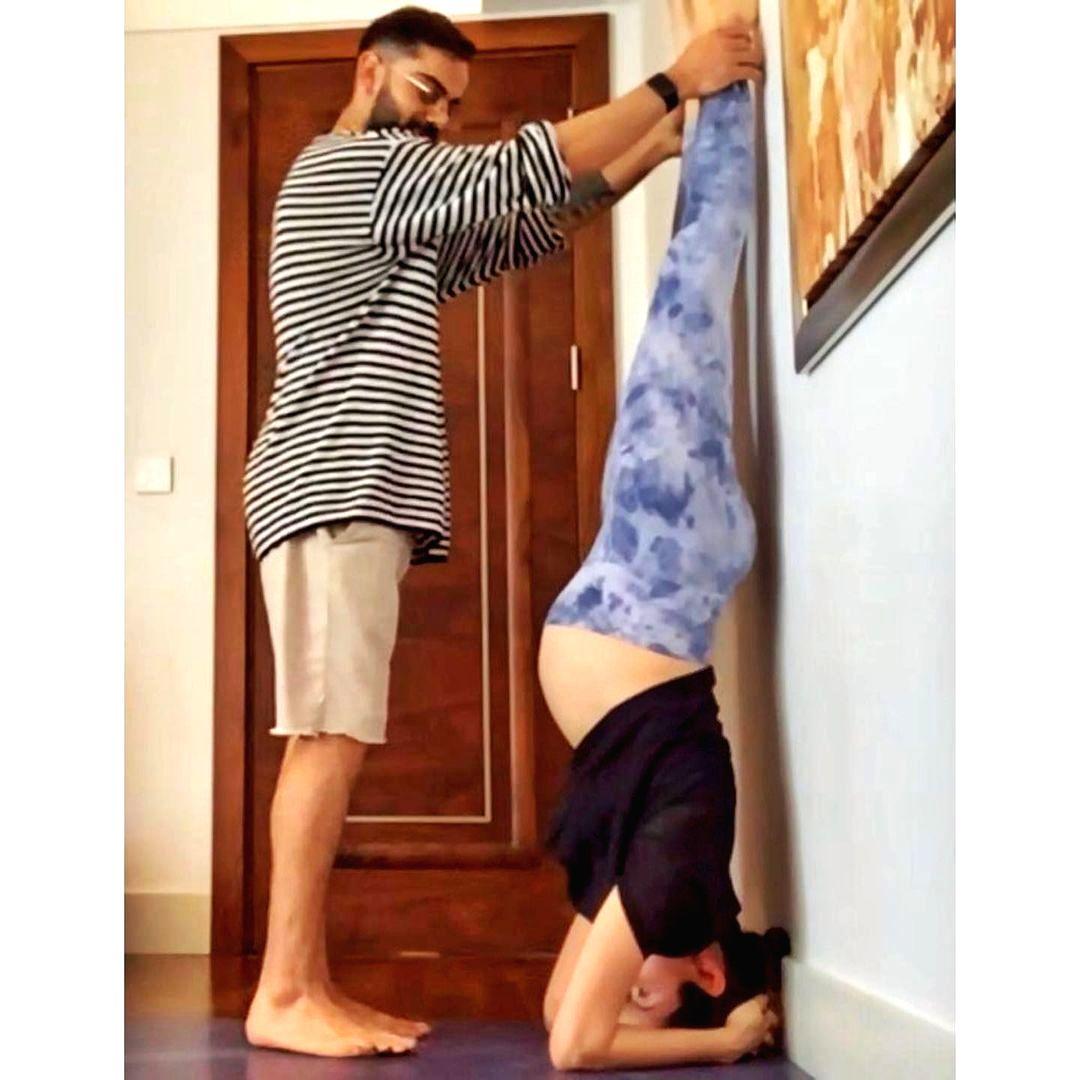 Pregnant Anushka Sharma performs Shirshasana with Virat's support.