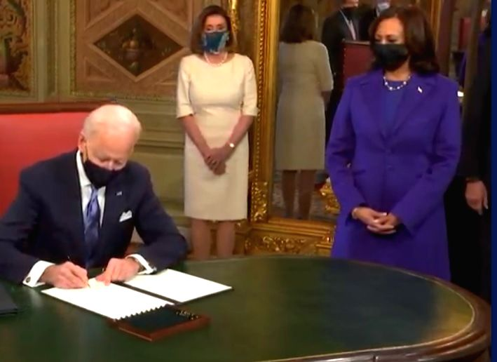 President Joe Biden signs the document of his inauguration at the president's office in the Capitol on Wednesday, January 20, 2021, after his swearing-in. (Photo: Biden Inaugural/IANS)