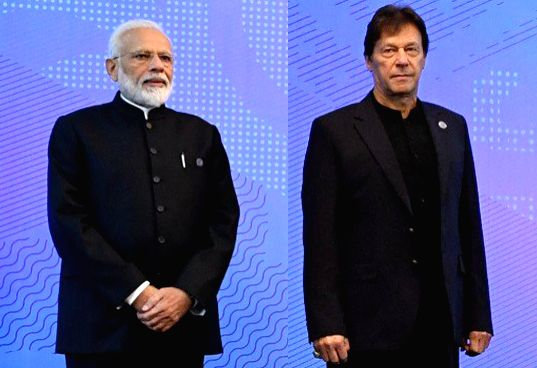 Prime Minister Narendra Modi and Pakistan Prime Minister Imran Khan  at the SCO (Shanghai Cooperation Organisation) Council of Heads of State Meeting in Bishkek, Kyrgyzstan on June 14, 2019. (File Photo: IANS)