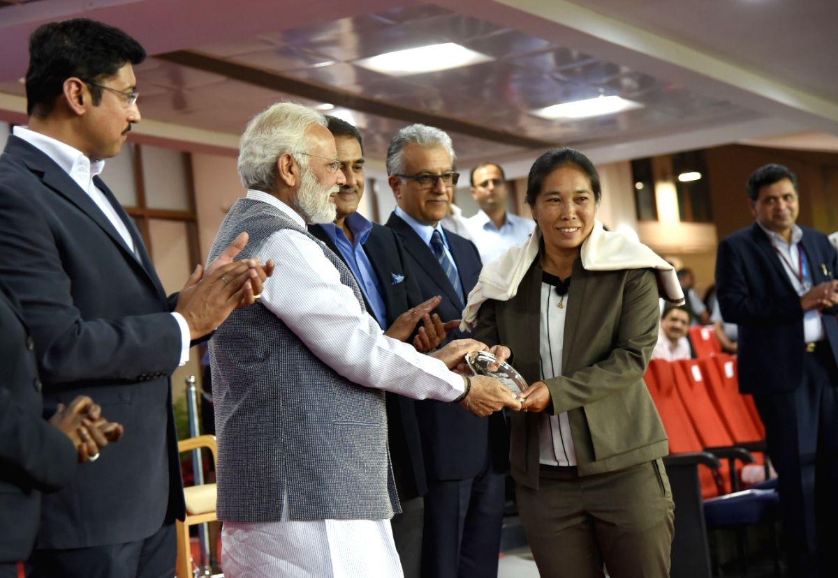 Modi felicitates Indian football legends - Narendra Modi and Rajyavardhan Singh Rathore