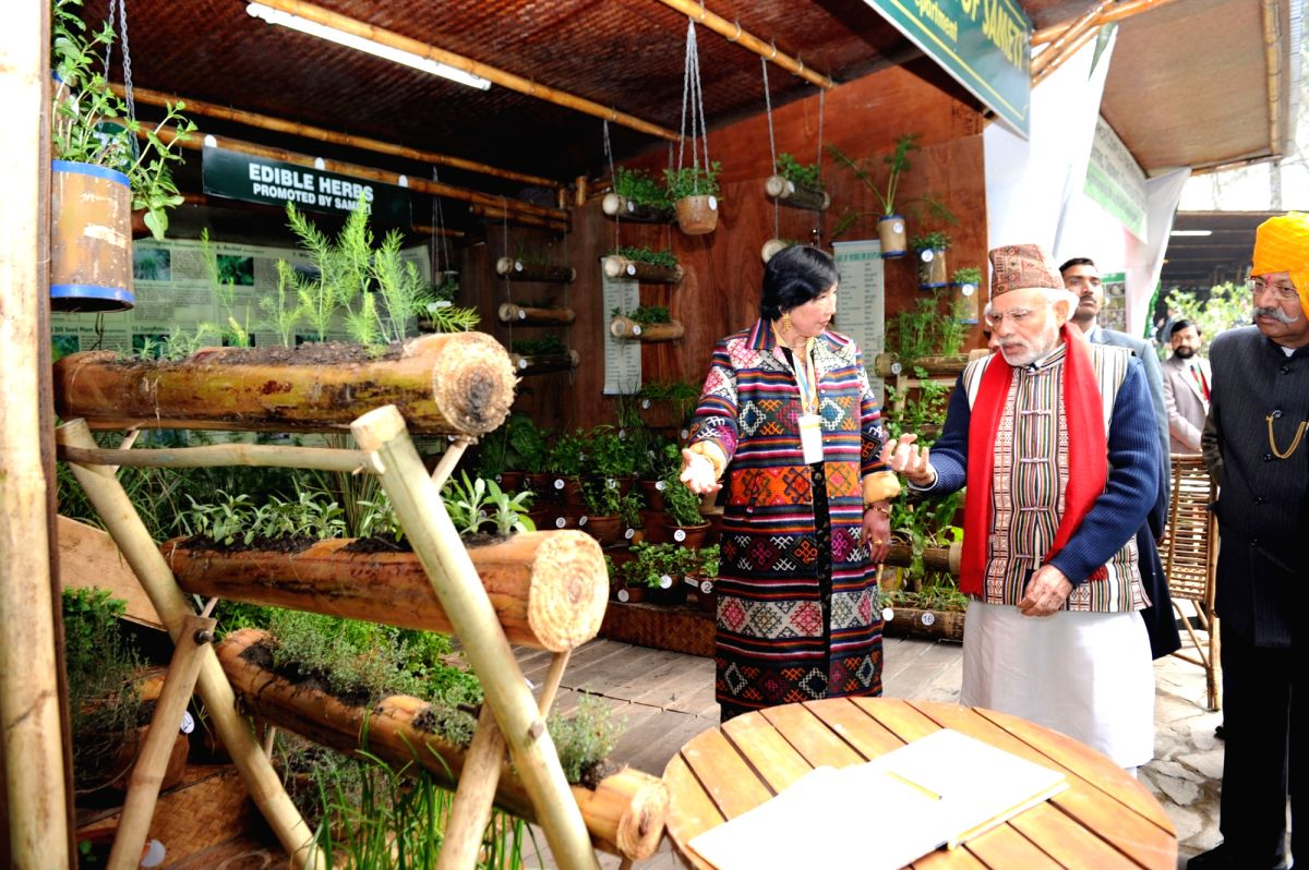 Prime Minister Narendra Modi visits the organic product exhibition, in Gangtok on January 19, 2016. Also seem Sikkim Governor Shriniwas Dadasaheb Patil.