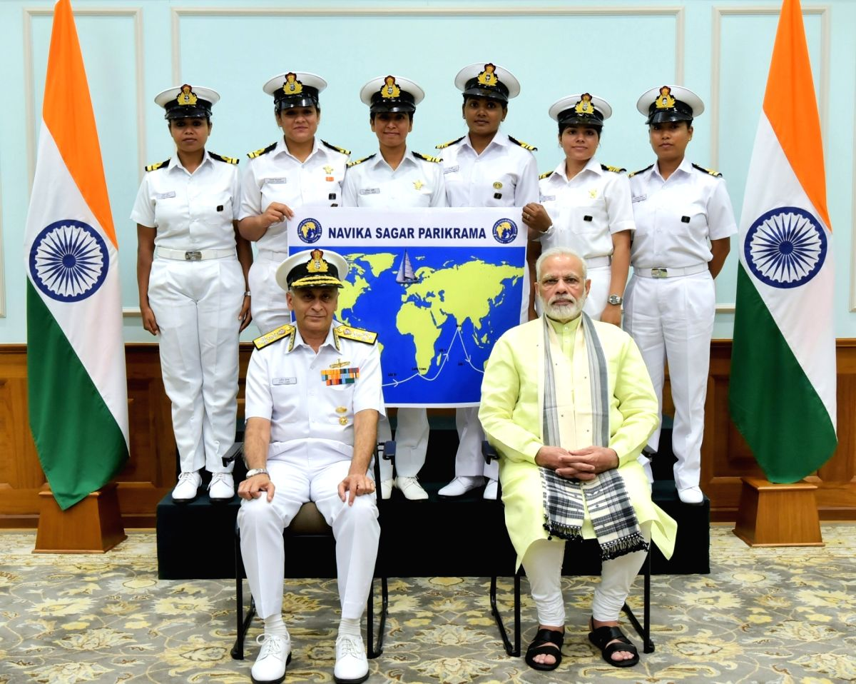 Prime Minister Narendra Modi with the six women officers of the Indian Navy who are due to circumnavigate the globe on the sailing vessel INSV Tarini in New Delhi on Aug 16, 2017. Also ...
