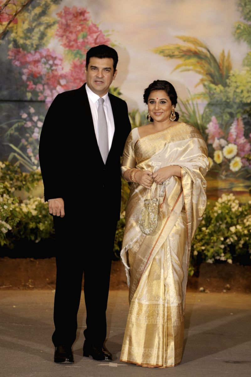 Vidya walks in with her Hubby!