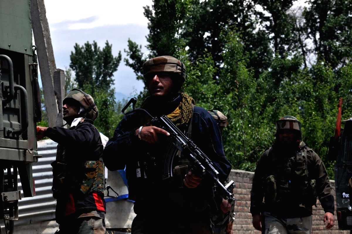 Pulwama: A security personnel during cordon and search operation after two militants were killed in a gunfight with the security forces, at Panzgam in Jammu and Kashmir's Pulwama district, on May 18, 2019. One of the slain militants has been identifi