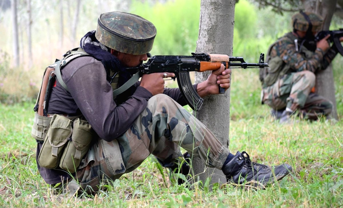 Pulwama: Soldiers take position during a gun fight between security forces and militants in which four people were killed in Jammu and Kashmir's Pulwama district on Aug. 26, 2017. The victims included a policeman, a Central Reserve Police Force (CRPF