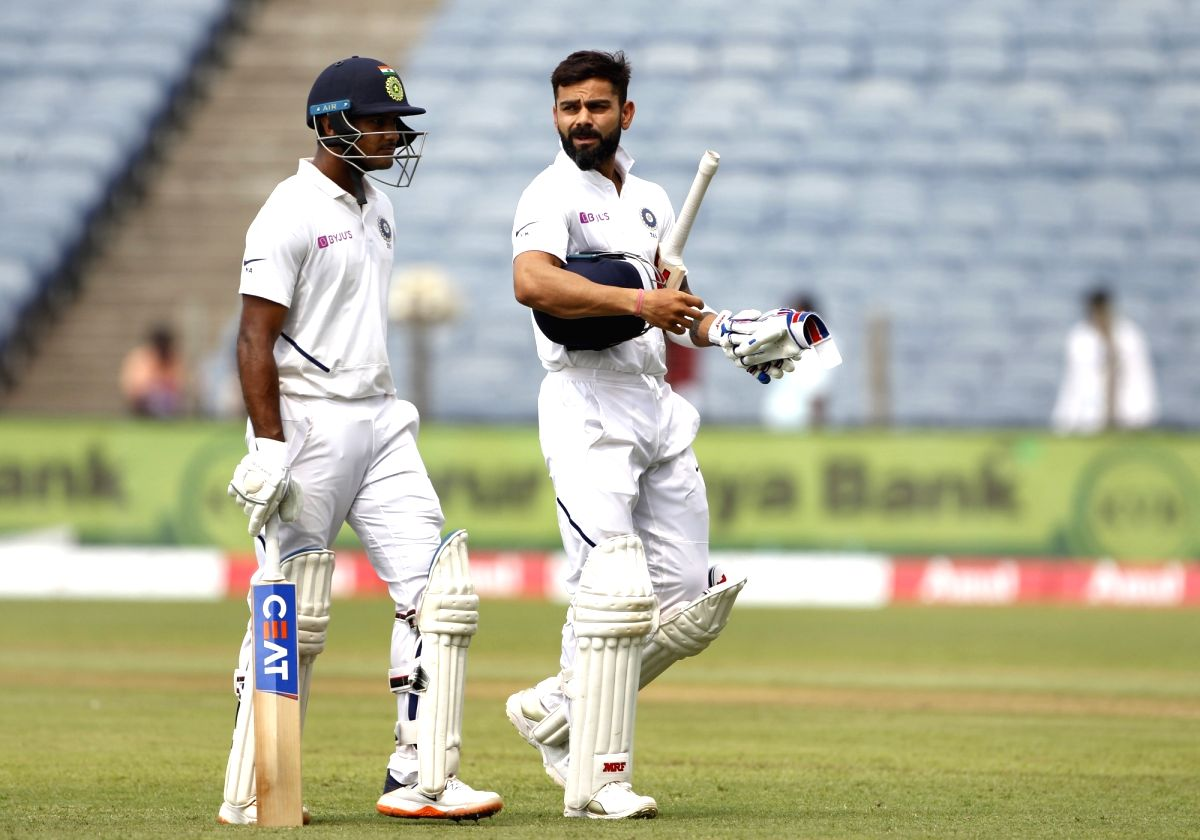 Pune: India's Virat Kohli and Mayank Agarwal at the end of Day 1 of the second Test match between India and South Africa at Maharashtra Cricket Association Stadium in Pune, on Oct 10, 2019. (Photo: Surjeet Yadav /IANS)