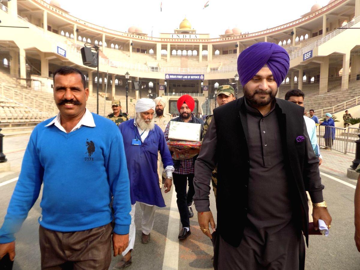 Punjab Minister Navjot Singh Sidhu on his way to Pakistan's Narowal to attend the ground breaking ceremony of Kartarpur Corridor, in Punjab's Attari on Nov 27, 2018.