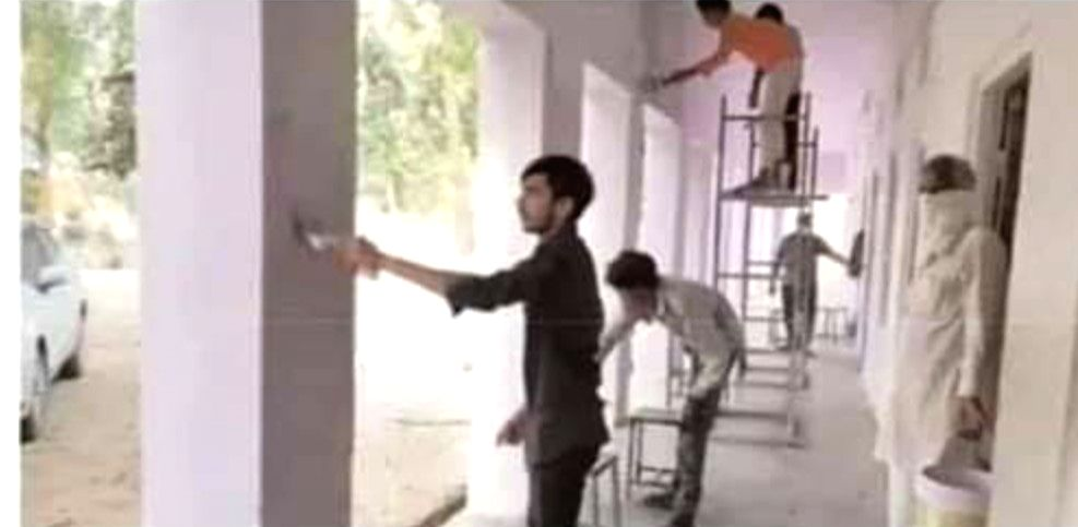 Quarantined migrant workers give new look school building in Raj.