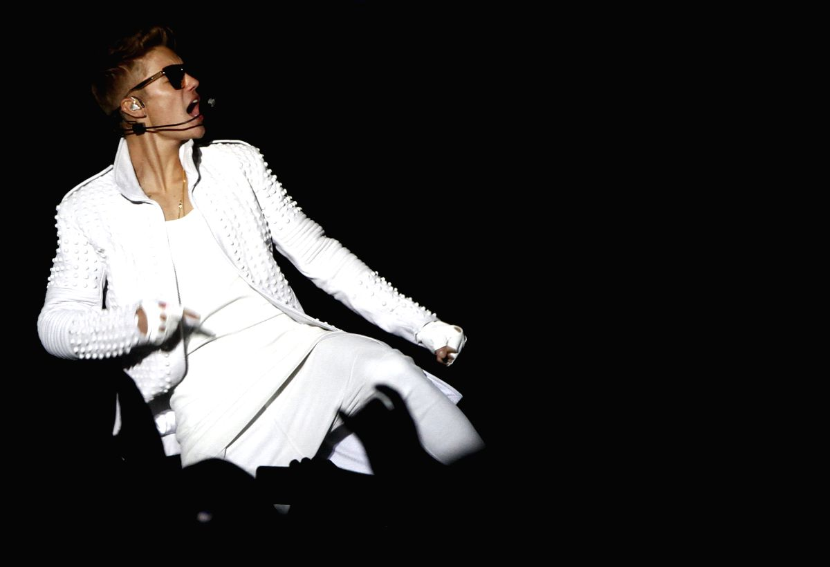 """QUITO, Nov. 1, 2013 (Xinhua/IANS) -- Canadian singer Justin Bieber performs during a concert, part of his """"Believe Tour"""", at the Olympic Stadium Atahualpa, in Quito, capital of Ecuador, Oct. 31, 2013. (Xianhua/Str) (py)"""