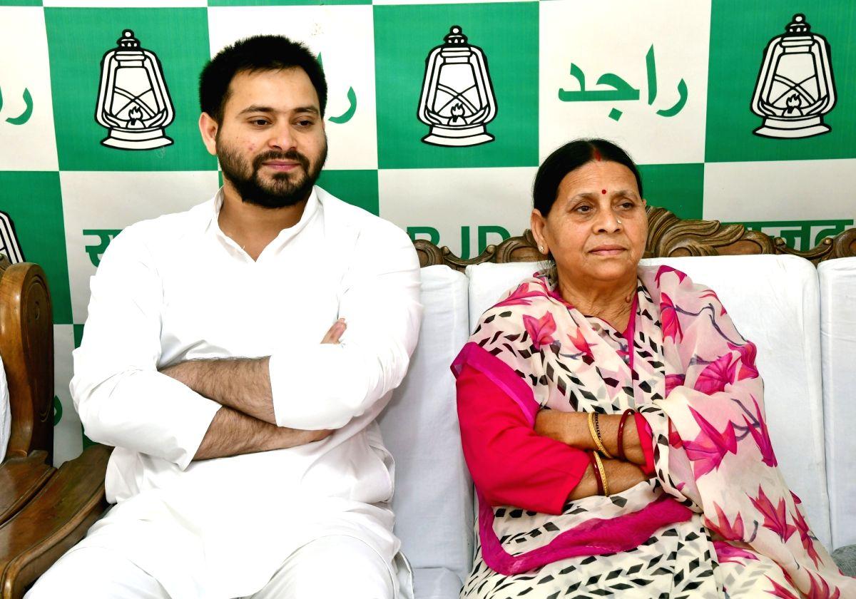 Rabri Devi and Tejashwi Yadav. (File Photo: IANS)