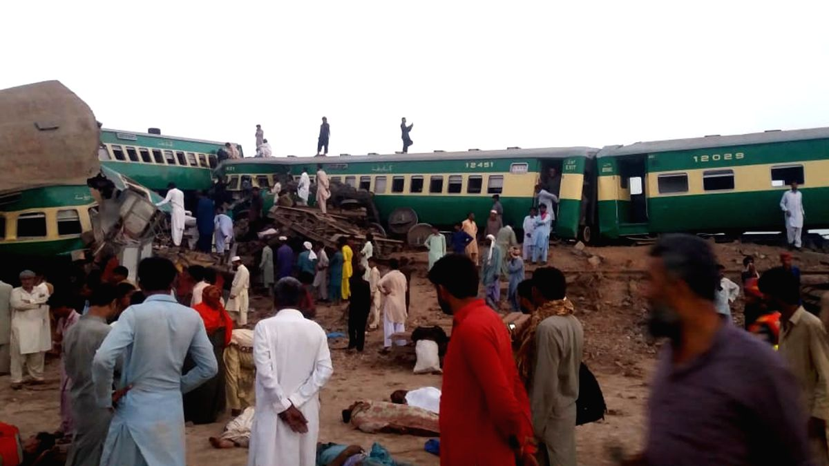 RAHIM YAR KHAN, July 11, 2019 (Xinhua) -- Photo taken with a mobile phone shows people gathering at the train accident site in Pakistan's eastern city of Rahim Yar Khan on July 11, 2019. A passenger train rammed into a freight train in Pakistan's eas