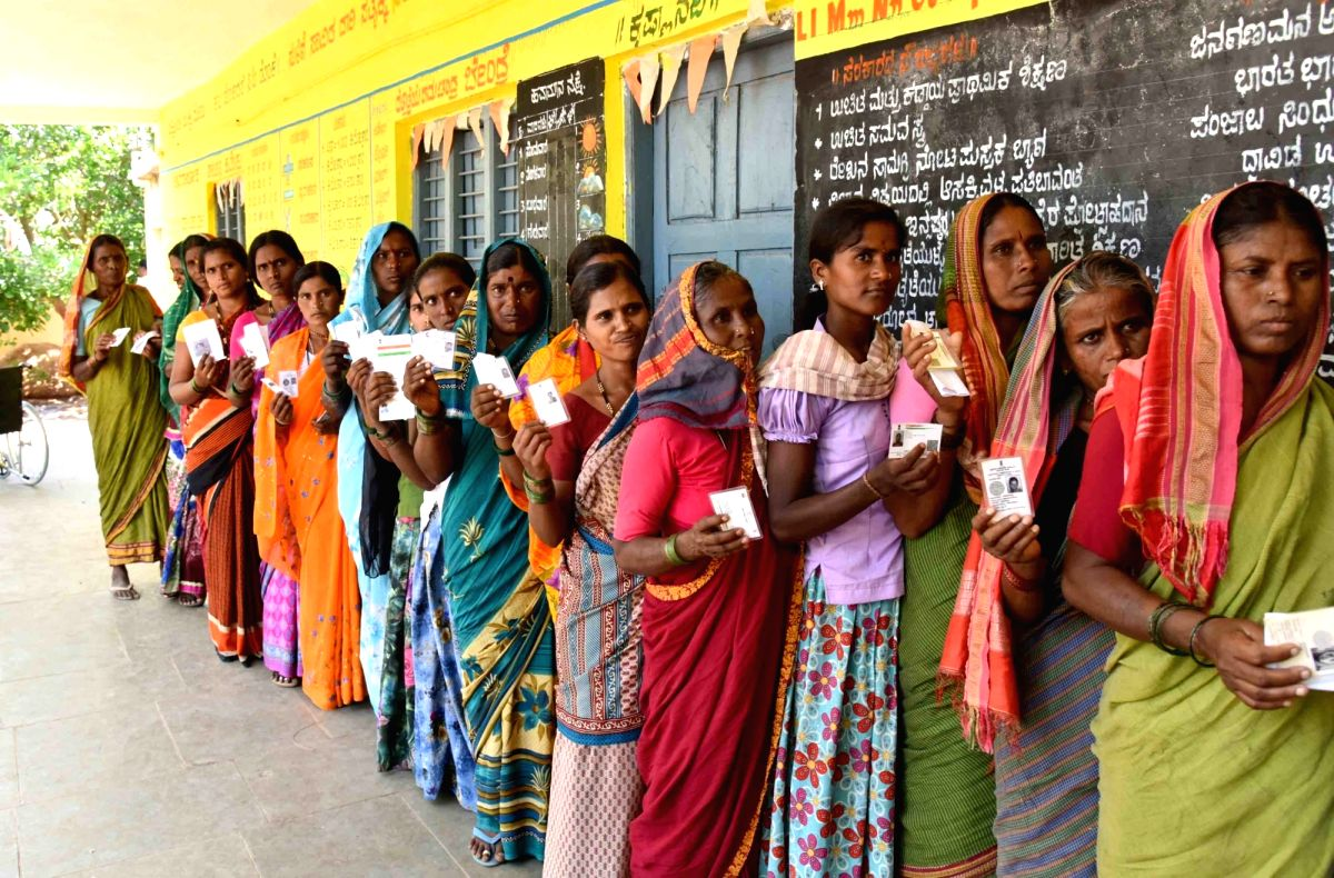 Raichur: Women voters wait in a queue to cast their votes for the third phase of 2019 Lok Sabha elections, at a polling station in Karnataka's Raichur, on April 23, 2019.